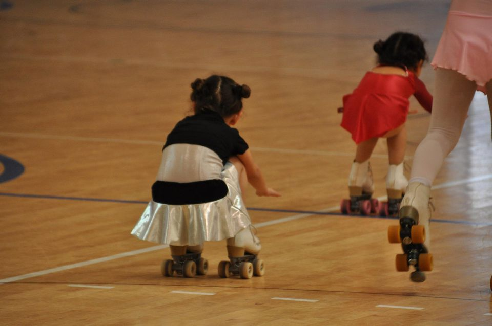 A picture of two kids roller skating