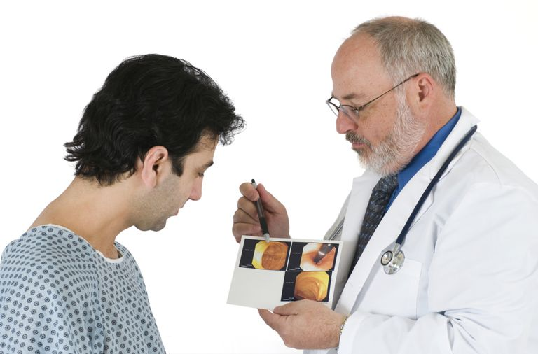Doctor and patient viewing colonoscopy images