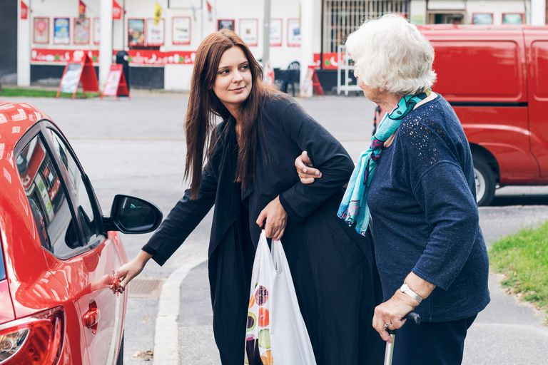 Young woman helping elderly woman