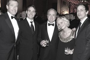 A photo of news anchor Brian Williams with members of the Saturday Night Live team.