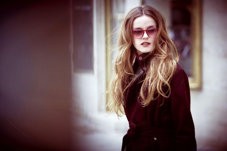Beautiful woman wearing tinted sunglasses
