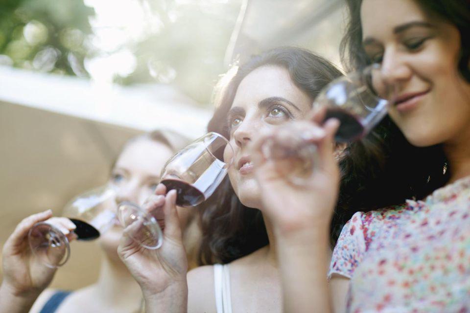 Women tasting wine at a vineyard