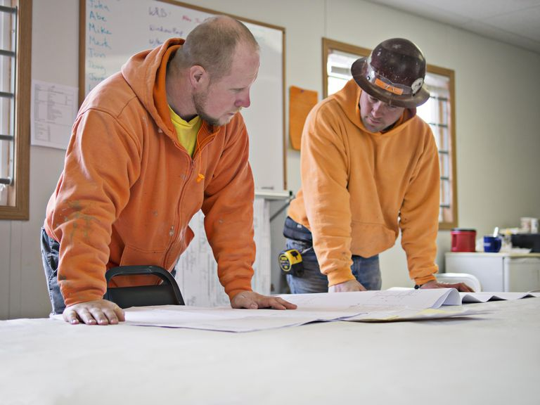 Two supervisors discuss construction plans
