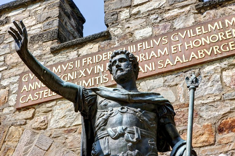 Bronze statue of Augustus the Roman emperor at the entrance of the reconstructed Saalburg the Roman fort, Limes, Taunus, Hesse, Germany