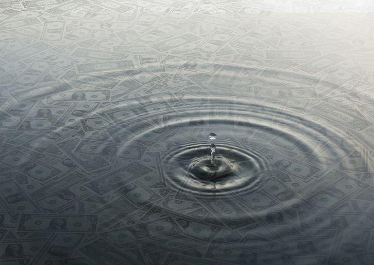 Ripple of water over dollar bills