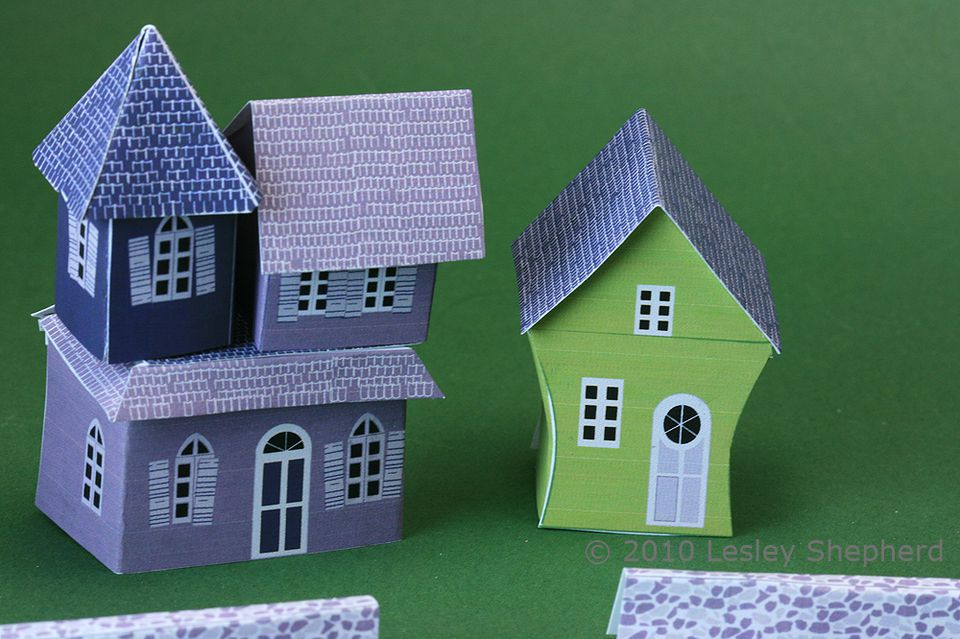 Miniature haunted houses and a stone fence in 1:144 scale made from printables.