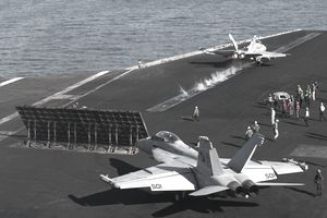 An F/A-18C Hornet launches from the the flight deck of USS Harry S. Truman.