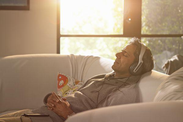 Man relaxing with headphones.