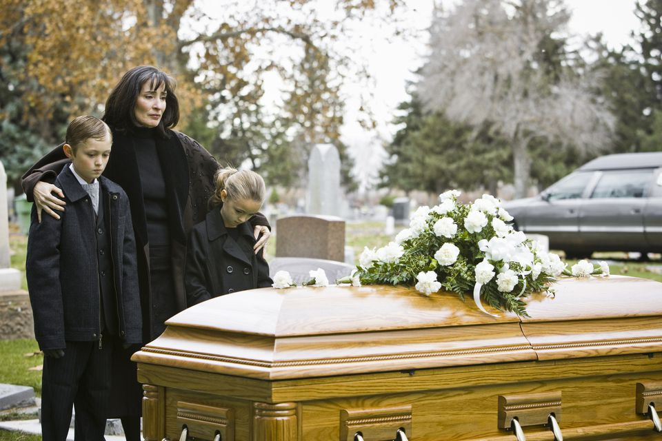Mother and children at funeral