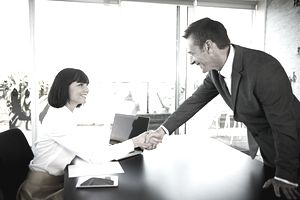 Businesswoman welcoming man to meeting