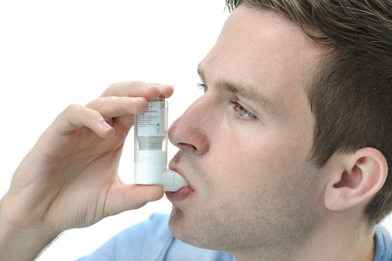 asthmatic man using an inhaler