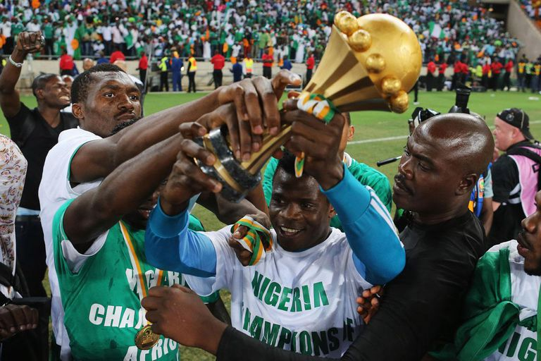 JOHANNESBURG, SOUTH AFRICA - FEBRUARY 10: Players from Nigeria celebrate with the trophy after winning the 2013 Africa Cup of Nations Final match between Nigeria and Burkina at FNB Stadium on February 10, 2013 in Johannesburg, South Africa.