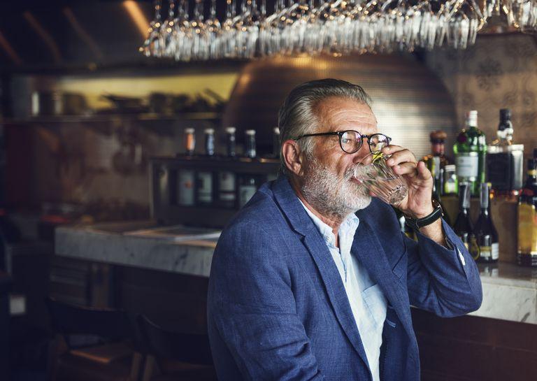 older man drinking at bar