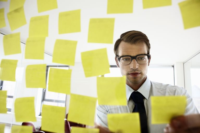 Man planning with sticky notes.