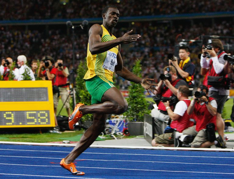 Usain Bolt gains the 2009 World Championship 100-meter gold medal, as well as the world record, by finishing in 9.58 seconds.