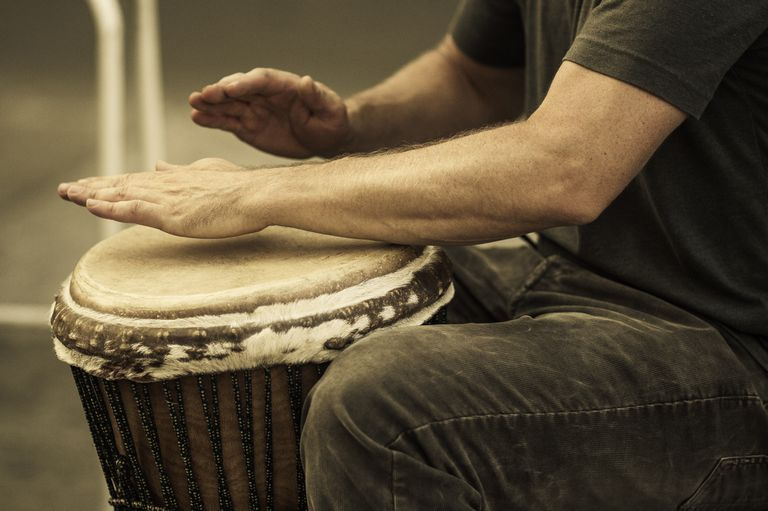 Man drumming with hands