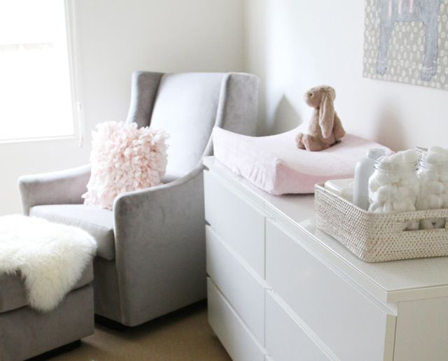 Nursery corner with comfortable nursing chair and changing station.
