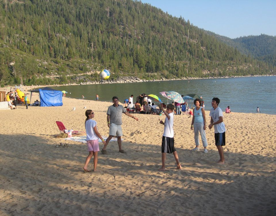 Family fun on the beach at Sand Harbor, Lake Tahoe Nevada State Park.