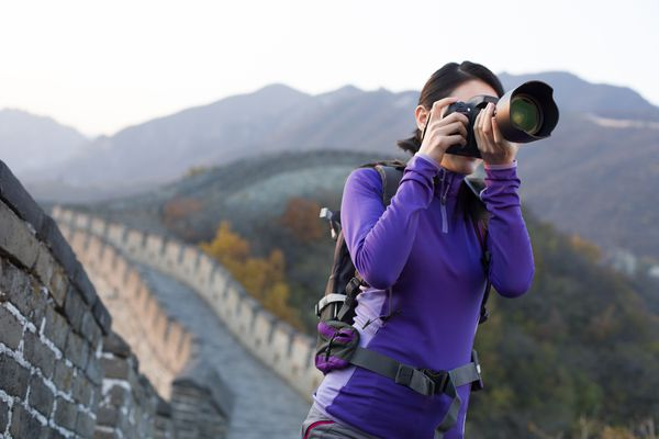 Young woman photographing on Great Wall