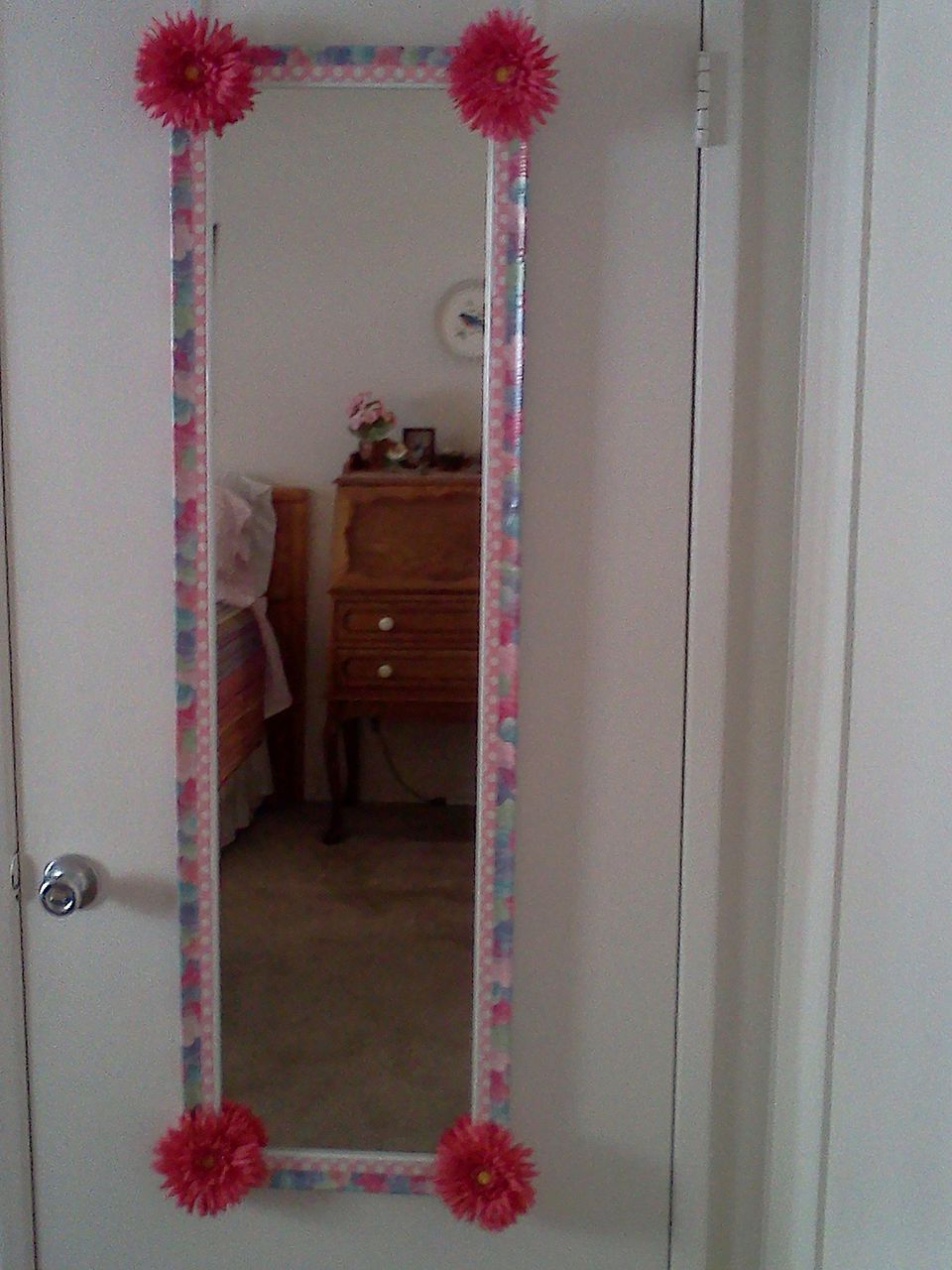 Use duct tape to decorate a mirror.