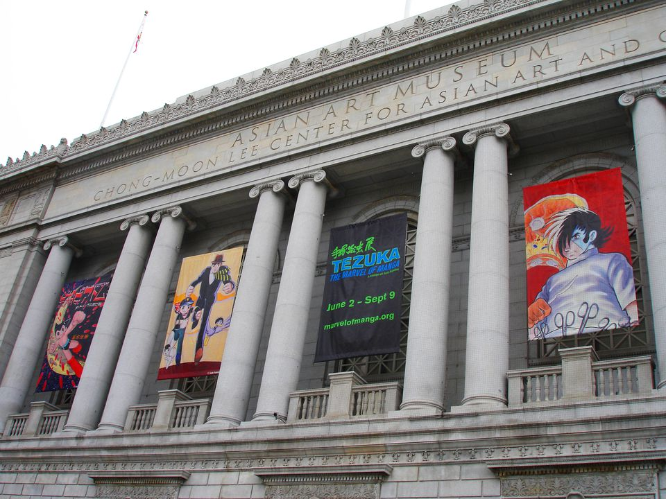 Exterior of the Asian Art Museum in San Francisco with banners advertising current exhibitions