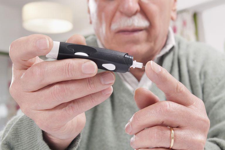 Man testing his blood sugar level