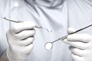 Dentist doing dental examination