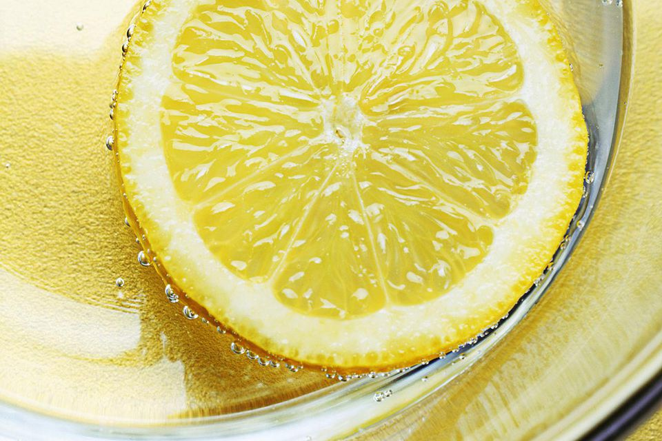 Slice of lemon in glass of water, close up