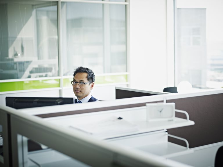 man working in cubicle office