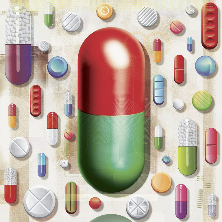 Large capsule standing out from the crowd of various pills and medicine