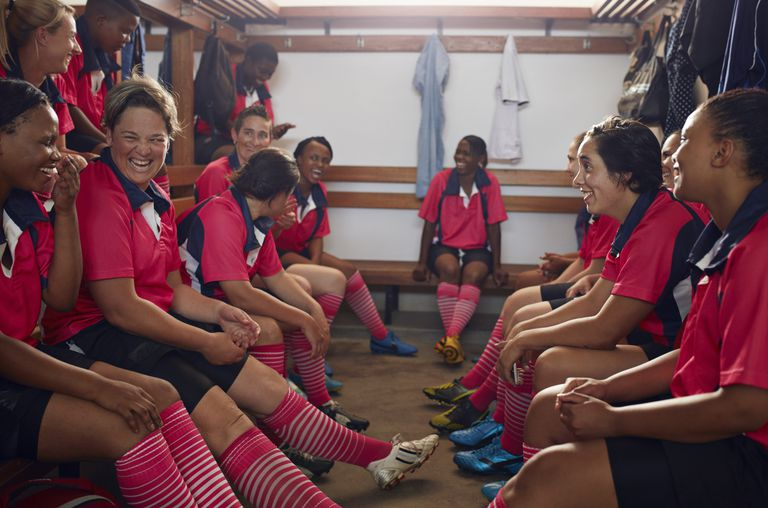 Womens rugby players laughing together before game