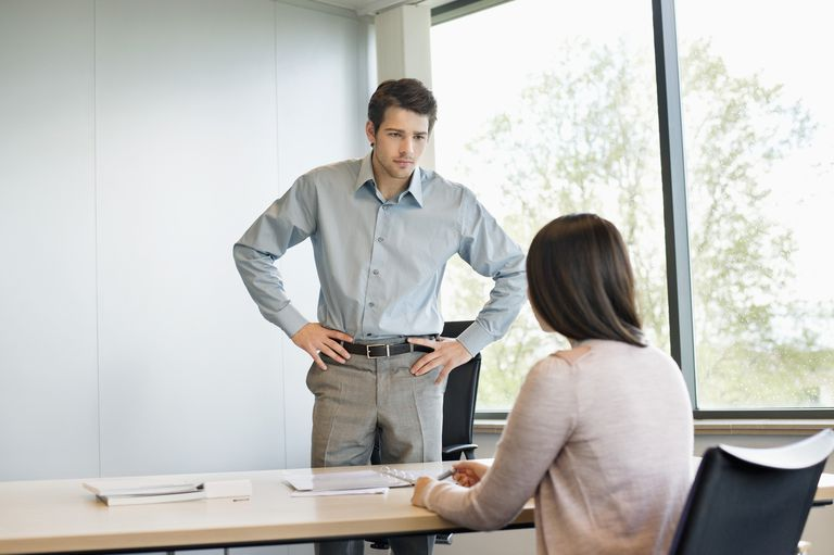 man being intimidating during job interview with woman