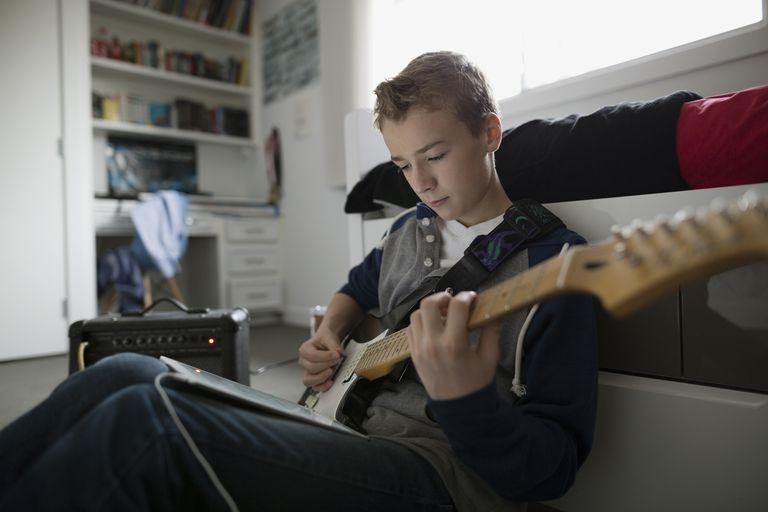 13-year-old boy playing guitar