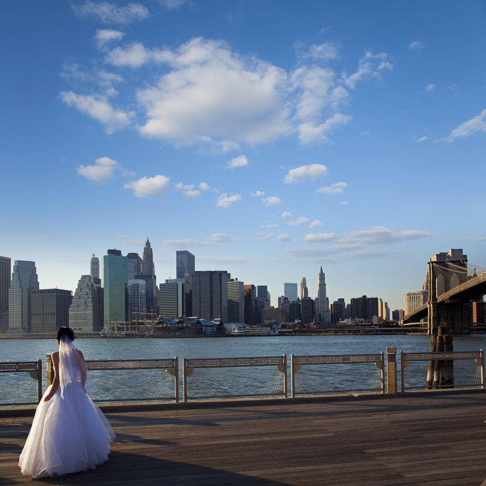 A bride against the Manhattan skyline.