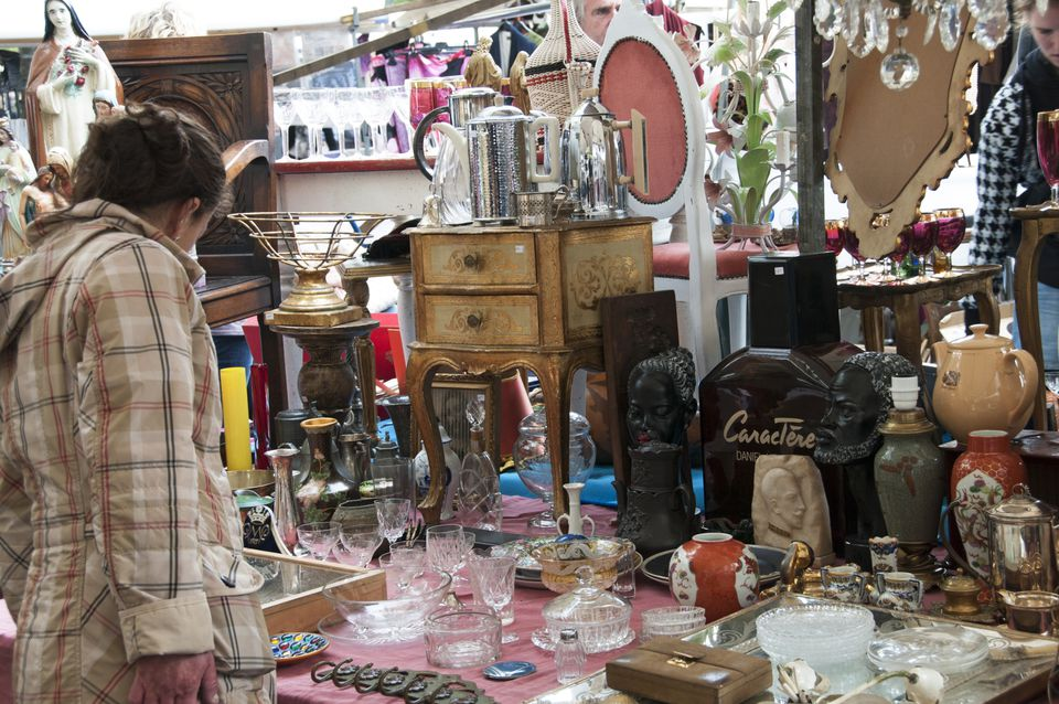 shopper browsing booth at an antique show