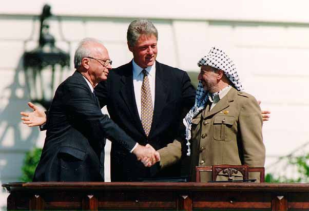 U.S. President Bill Clinton congratulates Israeli Prime Minister Yitzhak Rabin (left) and Palestinian Liberation Organization leader Yasser Arafat after they signed the Oslo Accords in September 1993.