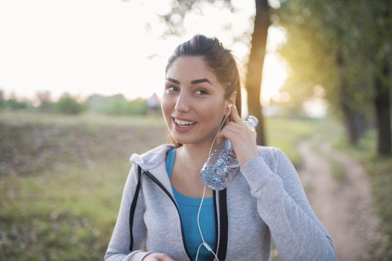 Woman with Earbuds Walking