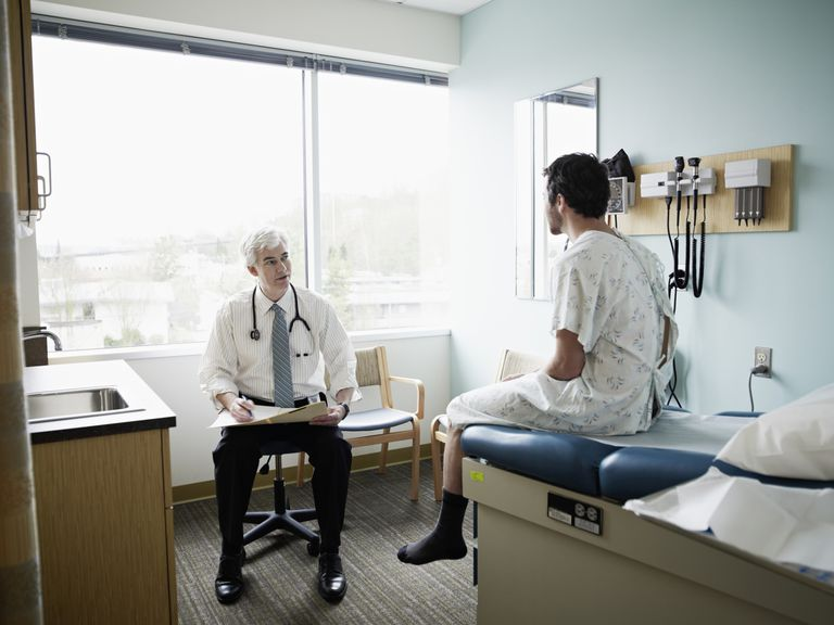 Male patient and doctor in discussion in exam room