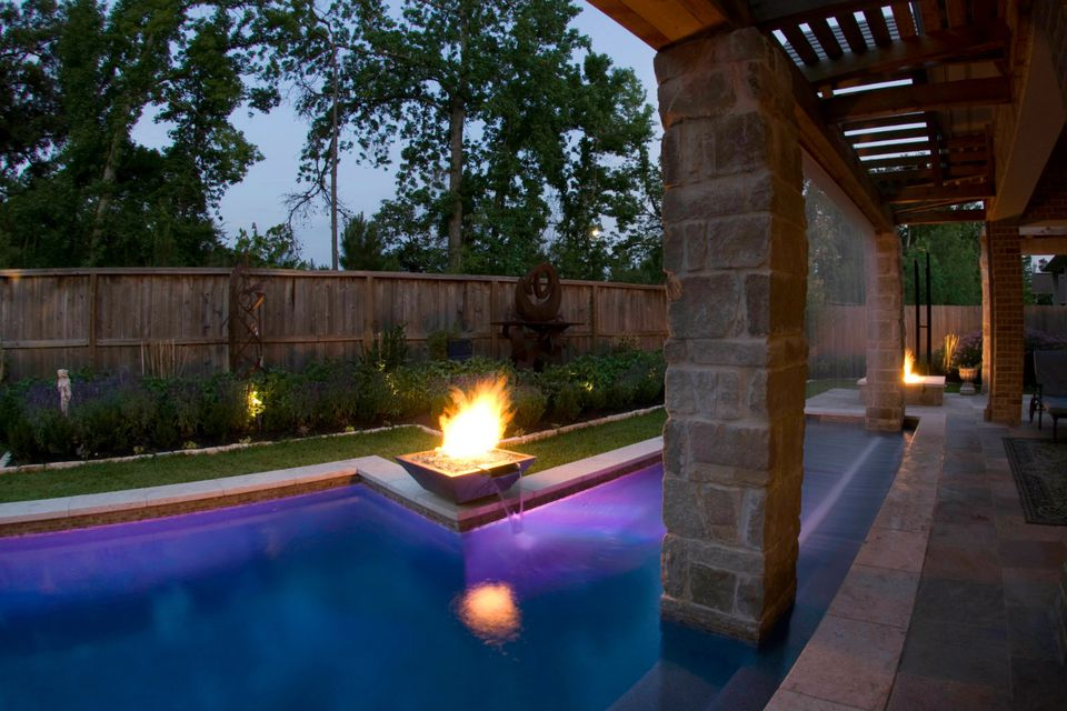 modern pool with fire bowl