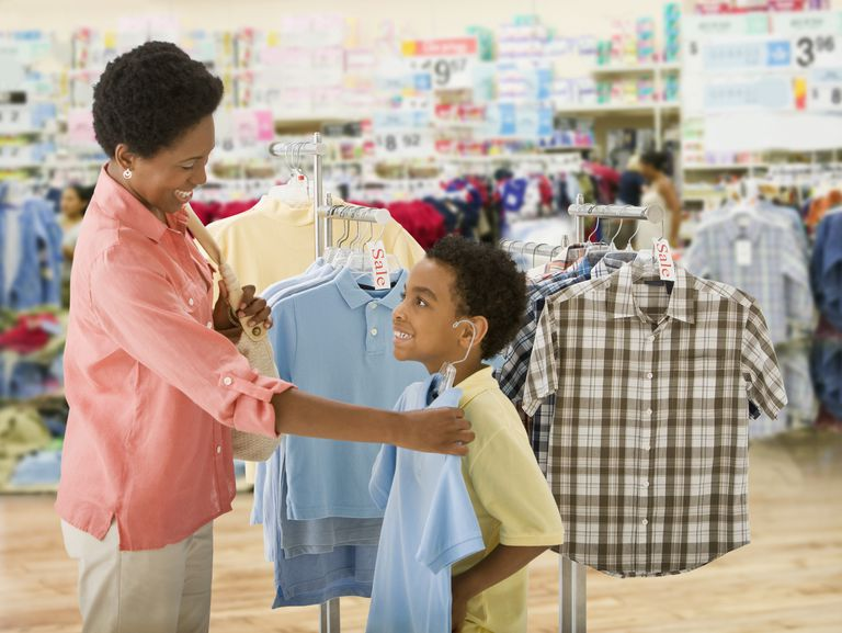 African mother and son clothes shopping