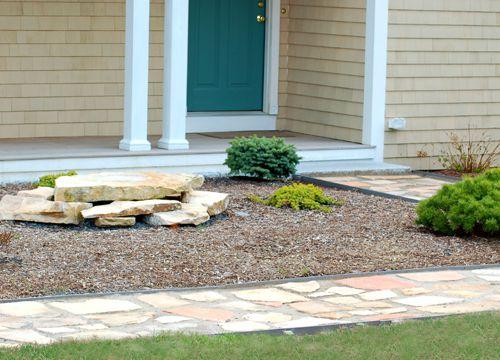 Photo of light-colored flagstone path.