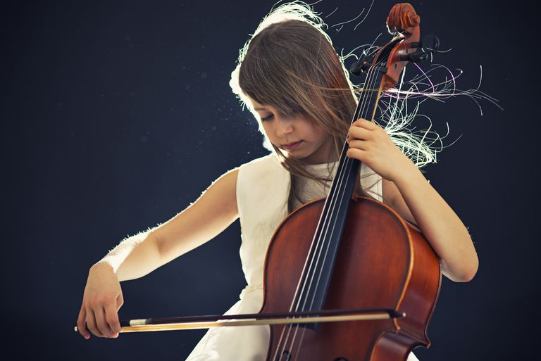 Little girl playing cello.