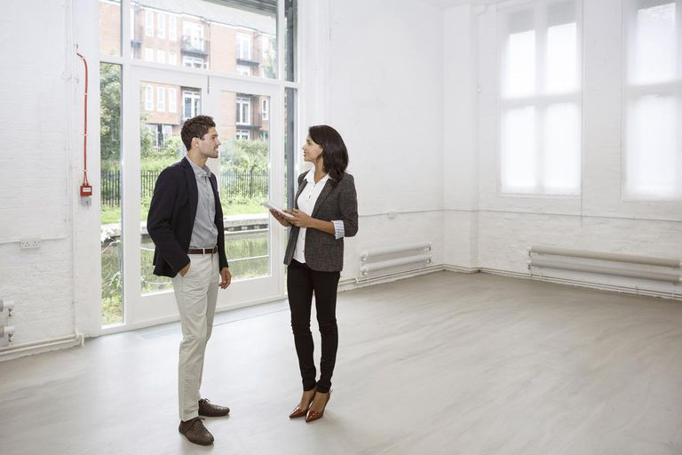 Young professional visiting loft with realtor