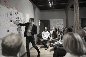 Market research analyst presents data to group