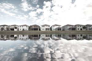 Houses reflected in water