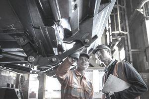 Engineers inspecting work in factory