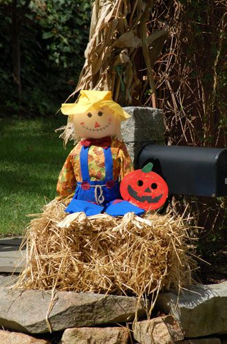 Picture: Scarecrow resting on a hay bale. Using hay bales is an easy way to support scarecrows.