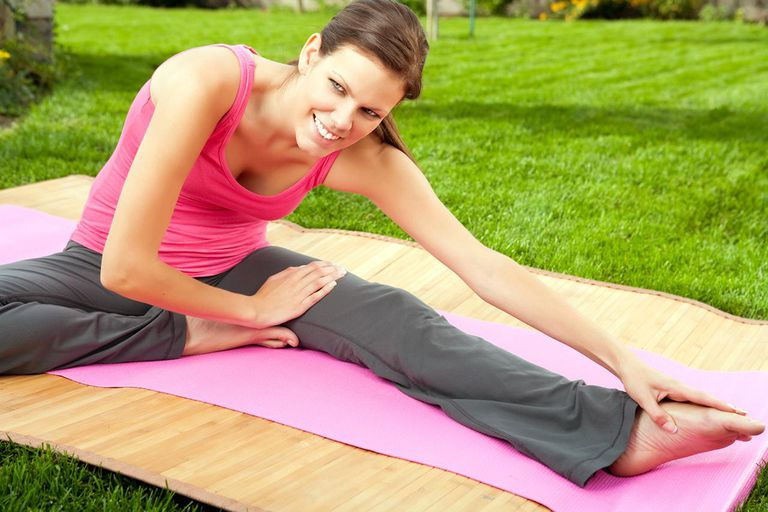 Smiling woman doing yoga outdoor