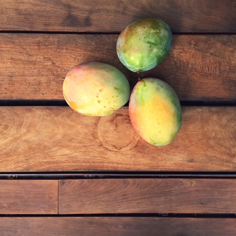 Mangoes on wooden table