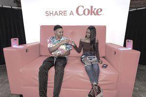 2 people sharing a coke